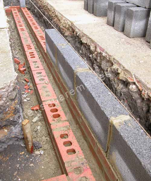 July 2008: The First Course Of Breeze Blocks. Both Wall Skins Were Built  With Dense Concrete Blocks Below Ground Level. Bricks ...