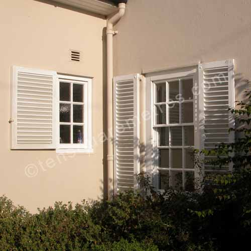 french shutters on 1920s house